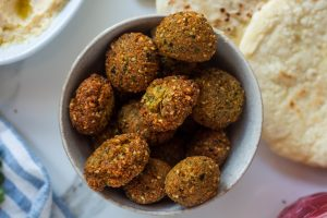 fried falafel balls in a pita bread