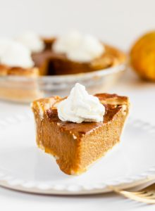 Pumpkin pie slice in a white plate
